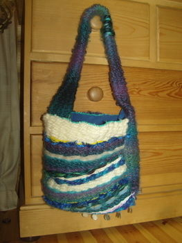 A shoulder bag made on a peg loom in varying shades of blue  .  Make a shoulder bag by sewing and weaving with scissors, yarn, and lining fabric. Inspired by hippy and clothes & accessories. Creation posted by surfergrl. Difficulty: Simple. Cost: 3/5.