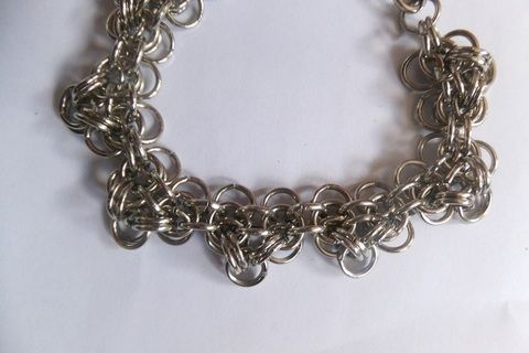 Fuelling my chainmaille addiction! .  Make a link bracelet in under 60 minutes by jewelrymaking and chainmailing with jump rings, lobster clasp, and jewlery pliers. Creation posted by Rawr.Rawr.x. Difficulty: 3/5. Cost: Absolutley free.
