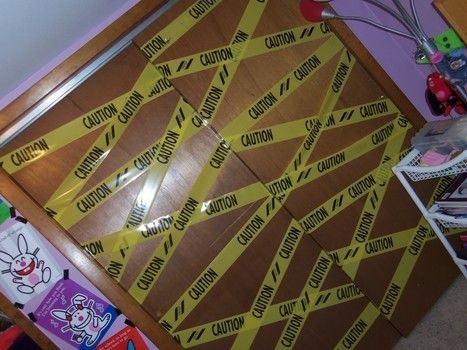 CAUTION :D .  Free tutorial with pictures on how to make wall decor in under 45 minutes using tape and caution tape. How To posted by Sammi<333. Difficulty: Simple. Cost: No cost. Steps: 4