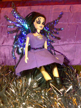 From a boring generic Disney princesses to an uba cool Goth fairy. .  Make an angel by hairstyling, braiding, fusing, sewing, wireworking, and decorating with fabric, wire, and acrylic paint. Inspired by christmas, gothic, and fairytale. Creation posted by Black Bunbun.  in the Decorating section Difficulty: 3/5. Cost: 3/5.