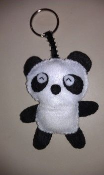Cute felt panda key chain .  Make a fabric animal charm in under 60 minutes by sewing with scissors, felt, and felt. Inspired by pandas. Creation posted by Vivian T. Difficulty: Easy. Cost: Absolutley free.