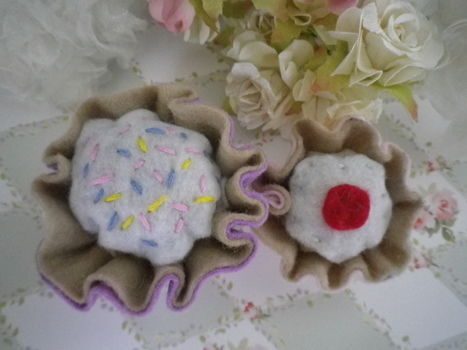 Cute easy to make yummy cupcake pin cusions! .  Make a pin cushions in under 5 minutes by decorating, embellishing, needleworking, embroidering, sewing, and felting with felt, needle, and stuffing. Inspired by vintage & retro, cupcakes, and cupcakes. Creation posted by Abigail D. Difficulty: Easy. Cost: Absolutley free.