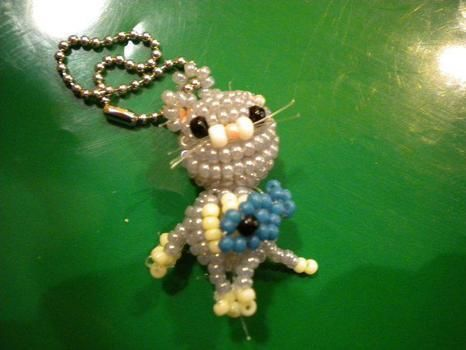 Made with coloured beads  .  Make a beaded animal by beading with beading thread and glass pearl beads. Inspired by cats, creatures, and vintage & retro. Creation posted by Kitiara. Difficulty: 3/5. Cost: No cost.