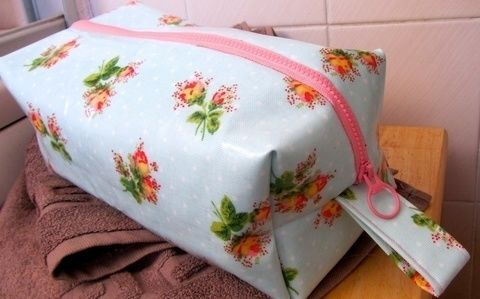 Keep your toiletries organised with a handy washbag. .  Free tutorial with pictures on how to make a washbag in under 60 minutes by sewing with thread, sewing machine, and zipper. Inspired by cath kidston. How To posted by Cat Morley. Difficulty: Simple. Cost: Cheap. Steps: 10