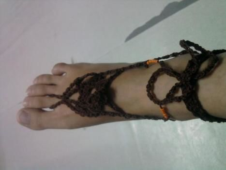 Barefoot crochet  .  Make a shoe in under 90 minutes by crocheting with yarn, beads, and hook. Creation posted by KhristineCrochet. Difficulty: Easy. Cost: No cost.