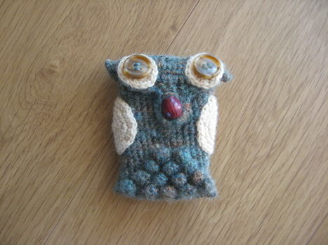 I'm so cute! You will want to hug me! .  Sew a fabric animal pouch in under 120 minutes by sewing and crocheting with yarn and buttons. Inspired by animals. Creation posted by Kelly S. Difficulty: Simple. Cost: Cheap.