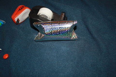 Simple, cute candy boxes from used (clean) cardboard TP rolls. .  Free tutorial with pictures on how to make a recycled box in under 10 minutes by creating, drawing, decorating, embellishing, papercrafting, collage, decoupaging, not sewing, and paper folding with candy and toys. Inspired by gifts, christmas, and halloween. How To posted by Abi L. Difficulty: Easy. Cost: Absolutley free. Steps: 5