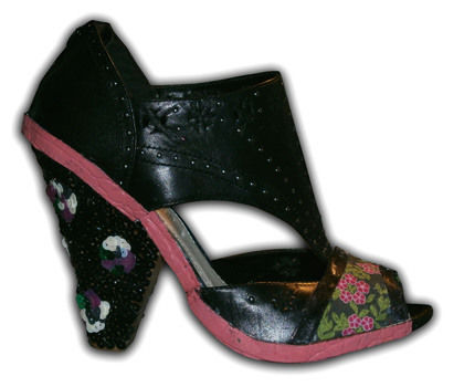 A D.I.Y. fashion homage to Nina Ricci's blooming fabulous blossom sequinned wedges .  Free tutorial with pictures on how to make a high heel shoe in 1 step by decorating with fabric, glue, and sequins. How To posted by Charley H. Difficulty: 3/5. Cost: Cheap.