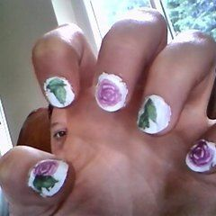 Tattoo Rose And Leaf Nails