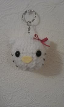 Ami key chain .  Make a keyring in under 100 minutes by needleworking and amigurumi with wool. Inspired by hello kitty and cats. Creation posted by KawaiiTartan. Difficulty: Easy. Cost: Absolutley free.