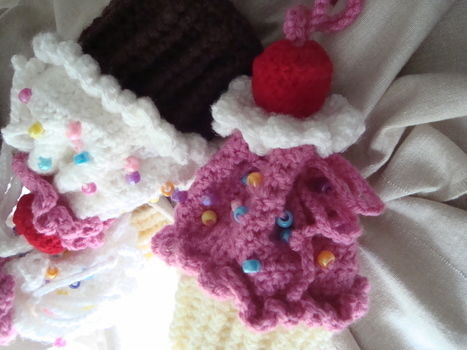 Cute, sugary-sweet must need accessory. .  Stitch a knit or crochet pouch in under 120 minutes by yarncrafting and crocheting with fabric, yarn, and crochet hook. Inspired by lolita, kawaii, and cupcakes. Creation posted by gypsie_jay. Difficulty: Easy. Cost: Cheap.