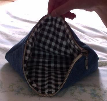 Recycle an old pair of jeans while you're at it!  .  Free tutorial with pictures on how to make a pouch, purse or wallet in under 60 minutes by needleworking and sewing with scissors, thread, and zipper. Inspired by crafts, people, and clothes & accessories. How To posted by Conn. Difficulty: Simple. Cost: Absolutley free. Steps: 12