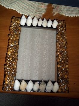 Mix it up! .  Make a photo holder in under 20 minutes by decorating and embellishing with beads, frame, and shell. Inspired by sealife. Creation posted by Ashley P. Difficulty: Easy. Cost: No cost.