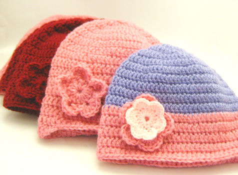 A step-by-step for absolute beginners on how to hold the yarn and everything! .  Free tutorial with pictures on how to make a floral beanie in 21 steps by crocheting with scissors, yarn, and crochet hook. How To posted by Mel W. Difficulty: Simple. Cost: No cost.