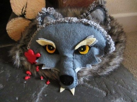 Red riding hood's outfit is completed by a wolf-skin hat .  Free tutorial with pictures on how to make an animal hat in under 120 minutes by sewing with felt, tights, and modelling clay. Inspired by halloween, gothic, and costumes & cosplay. How To posted by Boberts Pod. Difficulty: Simple. Cost: 3/5. Steps: 4