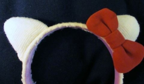 Made from old socks! .  Free tutorial with pictures on how to make a pair of cat ears in under 60 minutes by sewing with fabric, scissors, and glue. Inspired by crafts, halloween, and hello kitty. How To posted by Judy. Difficulty: Simple. Cost: No cost. Steps: 5