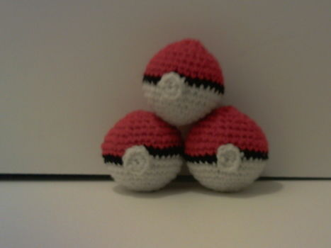 Pokemon, pets, dog, puppy, pokeball, ball, Christmas gifts, crochet, toy, plushies .  Make a pokeball plushie in under 60 minutes by yarncrafting, crocheting, and amigurumi with crochet hook, worsted weight yarn, and filling. Inspired by christmas and kawaii. Creation posted by Mochi Mochi. Difficulty: Easy. Cost: No cost.