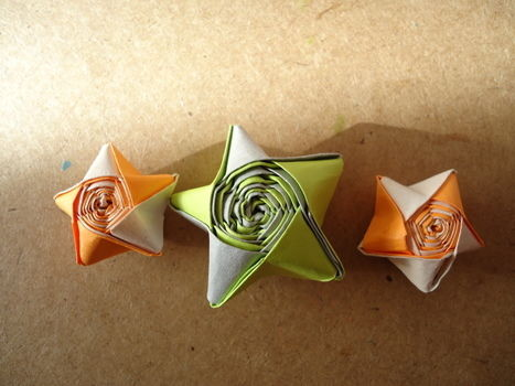 3D Paper Stars of 2 COLORS!!! XD .  Free tutorial with pictures on how to fold an origami star in under 15 minutes by decorating, papercrafting, and paper folding with scissors, paper, and glue. Inspired by vintage & retro, kawaii, and stars. How To posted by Gothic C. Difficulty: Simple. Cost: Absolutley free. Steps: 13