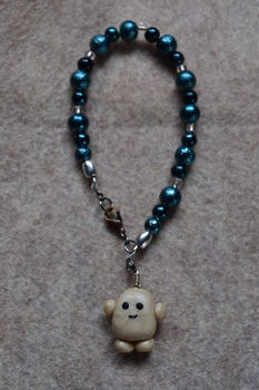 Adipose. It's Cute. .  Make a charm bracelet in under 60 minutes by beading, jewelrymaking, molding, and wireworking with beads, polymer clay, and nail polish. Inspired by gifts, kawaii, and clothes & accessories. Creation posted by Risa.Hanae (JapZilla). Difficulty: Simple. Cost: Cheap.