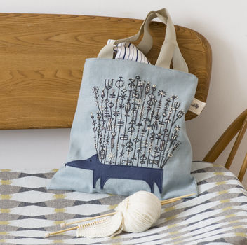Folk Art Needlecraft .  Free tutorial with pictures on how to make a tote bag in under 120 minutes by embroidering, needlepointing, and sewing with fabric, felt, and embroidery floss. How To posted by Ryland Peters & Small. Difficulty: Simple. Cost: Cheap. Steps: 9