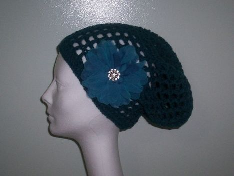 Quick & easy loc hat! .  Free tutorial with pictures on how to make a slouchy beanie in 2 steps by crocheting with crochet hook. Inspired by gifts and clothes & accessories. How To posted by Zenzele-Leandria Y.  in the Yarncraft section Difficulty: Simple. Cost: Cheap.