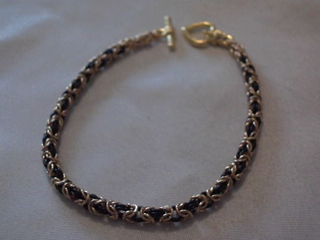 Byzantne weave chainmaille bracelet .  Free tutorial with pictures on how to make a link bracelet in under 120 minutes by chainmailing with jump rings, toggle clasp, and flat nose pliers. Inspired by gifts, gothic, and clothes & accessories. How To posted by VovsJewellery.  in the Jewelry section Difficulty: 4/5. Cost: 3/5. Steps: 11