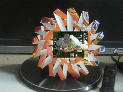 creative recycling of soda cans .  Free tutorial with pictures on how to make a frame / photo holder in under 3 minutes using can. Inspired by gifts. How To posted by Riya K.  in the Home + DIY section Difficulty: 3/5. Cost: No cost. Steps: 8