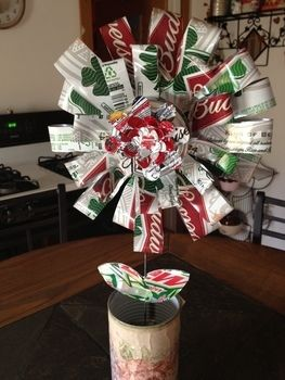 A trashy but classy creation .  Make a bouquet using can, bottles, and can. Creation posted by cupcake gangster.  in the Other section Difficulty: Easy. Cost: No cost.