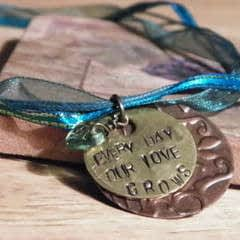 Love Grows Ribbon Necklace