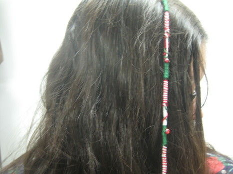 Get into the holiday spirit a little early with this festive Hair Wrap .  Free tutorial with pictures on how to make a hair accessory in under 90 minutes by braiding and jewelrymaking with hair, embroidery, and plastic beads. How To posted by Tawny B. Difficulty: 3/5. Cost: Absolutley free. Steps: 10