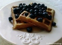 Oatmeal Banana Waffles Topped With Blueberries In Syrup