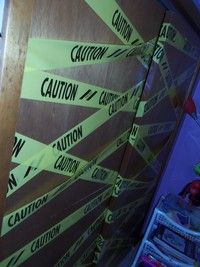 How to make door decor. Caution Tape Doors - Step 4
