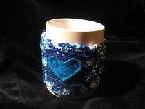 Crocheted Squirly Heart Mug Cosy