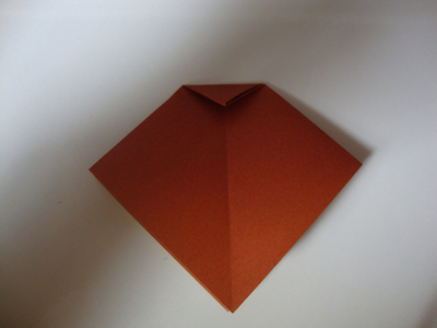 How to fold an origami shape. Origami Bows - Step 6