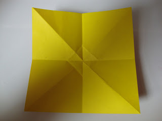 How to fold an origami shape. Origami Bows - Step 7