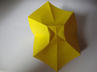 How to fold an origami shape. Origami Bows - Step 9