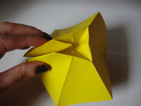 How to fold an origami shape. Origami Bows - Step 10