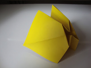 How to fold an origami shape. Origami Bows - Step 11