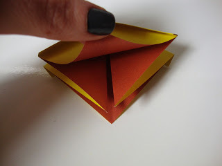 How to fold an origami shape. Origami Bows - Step 16