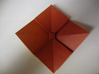 How to fold an origami shape. Origami Bows - Step 17