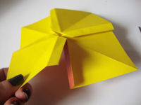 How to fold an origami shape. Origami Bows - Step 20