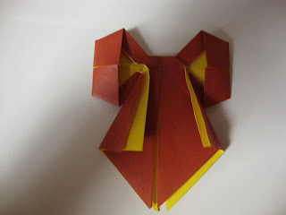 How to fold an origami shape. Origami Bows - Step 27