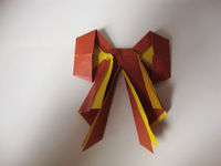 How to fold an origami shape. Origami Bows - Step 28