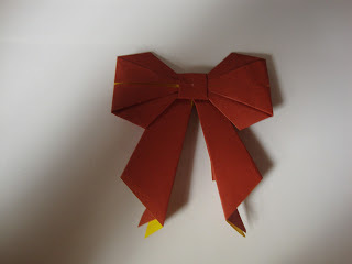 How to fold an origami shape. Origami Bows - Step 29