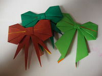 How to fold an origami shape. Origami Bows - Step 30