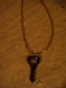 Gold And Black Key Necklace