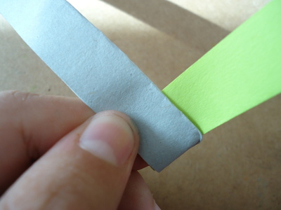 How to fold an origami star. Bicolor Paper Star - Step 5