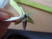 How to fold an origami star. Bicolor Paper Star - Step 10
