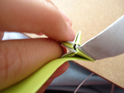 How to fold an origami star. Bicolor Paper Star - Step 11