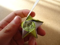 How to fold an origami star. Bicolor Paper Star - Step 13